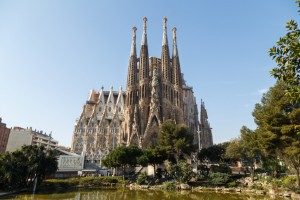 Sagrada Familia is one of the iconic symbols of Barcelona. It is a Roman Catholic church which construction has started in 1882 by the famous Catalan architect Antoni Gaudi and it is still under construction. At the photo is a view of the Nativity facade of Sagrada Familia from Placa de Gaudi.