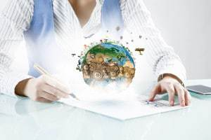 Close view of businesswoman writing with pen. Elements of this image are furnished by NASA